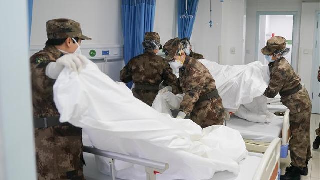 Military staff fly to Wuhan to aid coronavirus control