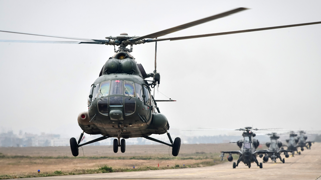 Multi-type helicopters lift off for real combat flight