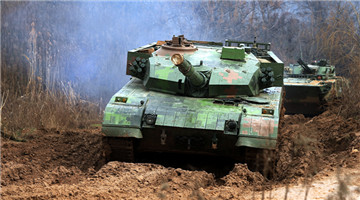 MBTs and IFVs pass through muddy road