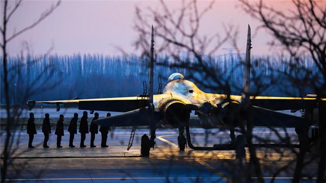 Ground crews go through final checks before flight