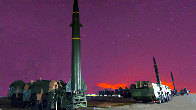 Rocket force soldiers erect ballistic missile systems at night