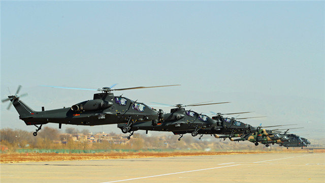 Multi-type helicopters hover over