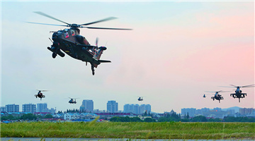 Attack helicopters fly at ultra-low altitude