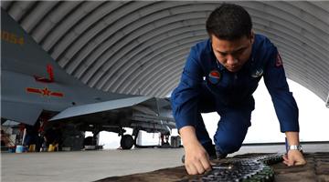 Ground crew check ammunition in advance