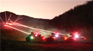 Tanks spit fires at night