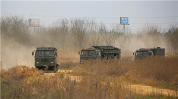 Armored vehicles en route to training area