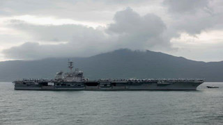 U.S. carrier Roosevelt sailors to be quarantined on Guam