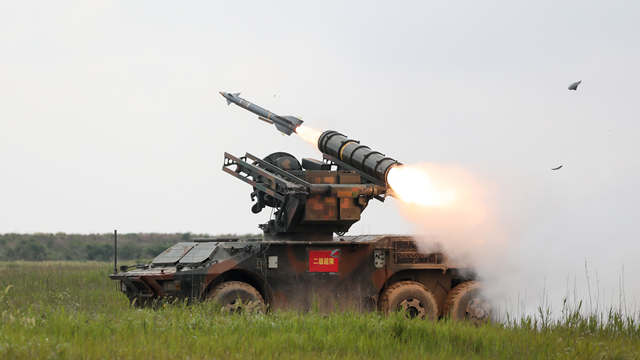 Missile launching vehicle in live-fire test