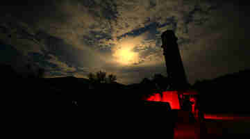 Rocket Force soldiers erect ballistic missiles at night
