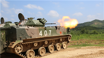 Armored vehicles in live-fire training