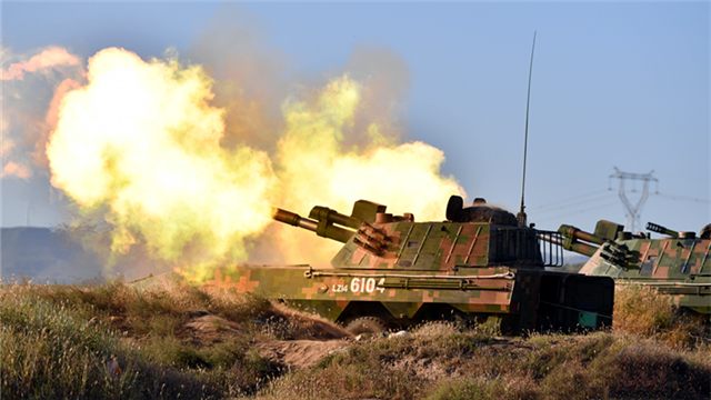 Armored vehicles participate in live-fire drill