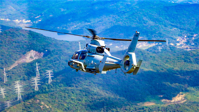 Helicopters patrol over mountainous region