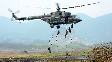 Soldiers fast rope from transport helicopter
