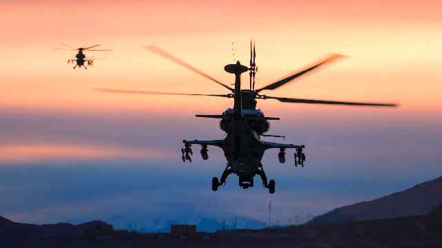 Gunship formation takes off in morning light