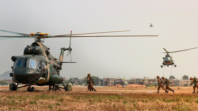 Soldiers fast-rope from transport helicopters