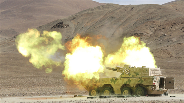 Vehicle-mounted howitzers fire high explosive shells