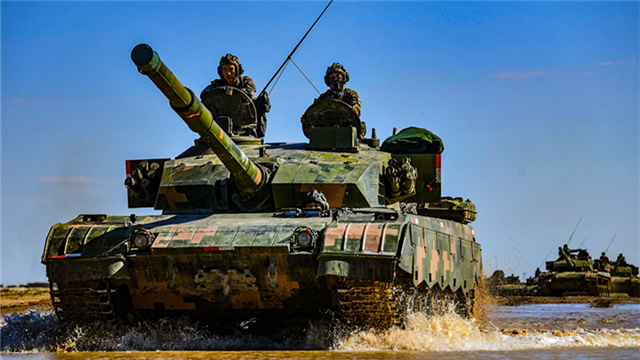 MBTs drive through mire