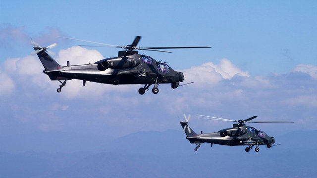Helicopters fly in formation during training exercise