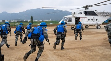 Chinese peacekeeping special operations soldiers fast-rope for escort task