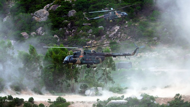 Military helicopters in defense penetration training