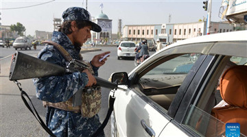 Members of Taliban stand guard at security checkpoint in Kandahar city, Afghanistan