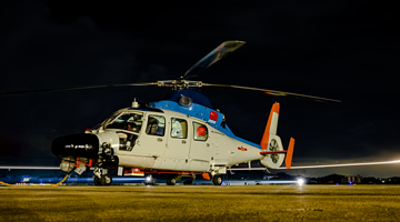 Naval helicopters conduct search and rescue training