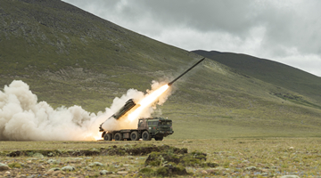 Long-range Multiple Launch Rocket Systems conduct salvo of shells