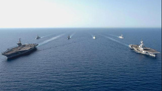 Why US deploys multiple carrier strike groups in Western Pacific?