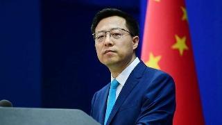 China urges Japan to make clean break with militarism